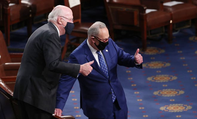 Sen. Patrick Leahy (L) and Senate Majority leader Chuck Schumer react before US President Joe Biden arrives to deliver his first address to a joint session of Congress at the US Capitol in Washington, DC, on April 28, 2021.