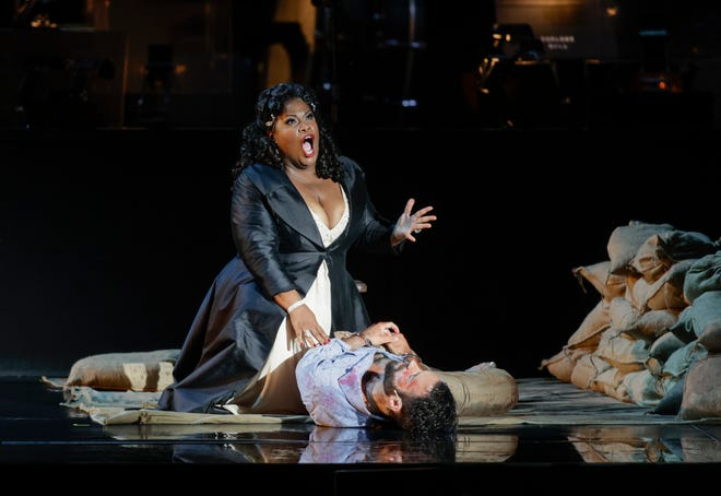 "Latonia Moore as Tosca and Adam Smith as Cavaradossi in Austin Opera's ""Tosca"" at Circuit of the Americas. Performers went on through an almost steady drizzle Thursday night at the amphitheater."