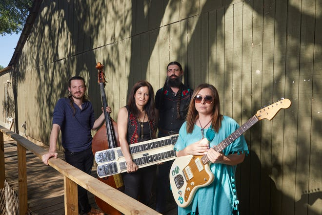 "Ida Red members Phil Spencer, from left, Rose Sinclair, Jason Baczynski and Sophia Johnson pose for a portrait at Sam's Town Point on April 25. Their debut album, ""Harmony Grits,"" is out this month."