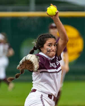 Round Rock pitcher Maddy Azua winds up for a delivery in the Dragons' 2-1 win over Austin High on Friday. Azua struck out 10 and drove in the winning run to help Round Rock advance to the area round of the playoffs.