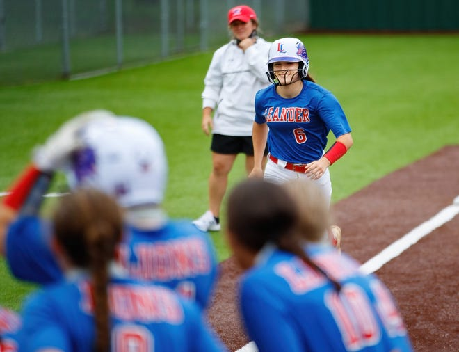 Leander's Marley Neises approaches home plate and her waiting teammates after hitting a grand slam against Seguin on Thursday. The top-ranked Lions swept the Matadors by a combined score of 34-0.