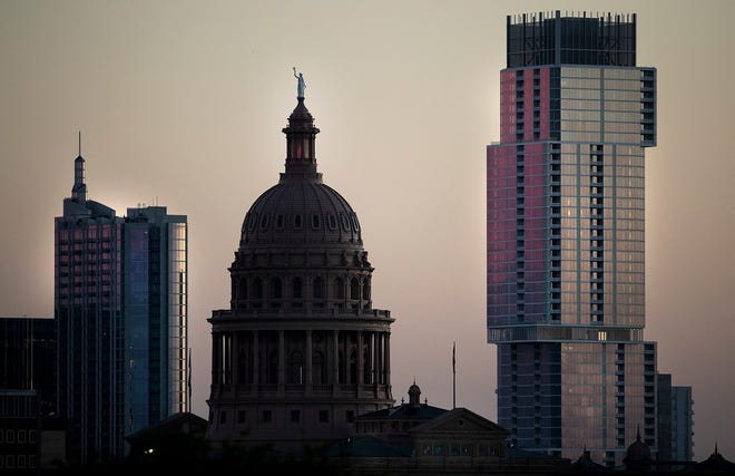 The Texas Capitol building is seen in the Austin skyline in this 2019 file photo. GOP lawmakers are attacking Austin, Harris County and local communities for exerting local budget control, Austin City Council Member Greg Casar and Harris County Commissioner Rodney Ellis write. [NICK WAGNER/AMERICAN-STATESMAN]