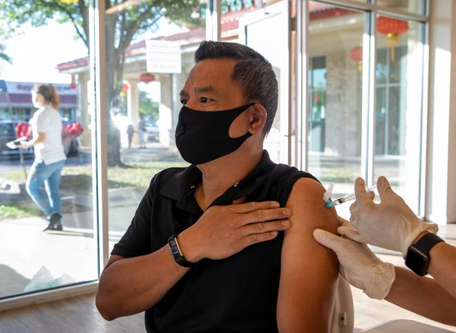"""Tung Nguyen, 47, receive the COVID-19 vaccine on April 11, in Austin. """"It's not for me, it's for my family,"""" Nguyen said."""