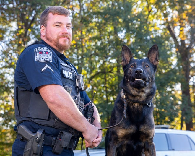 Athens-Clarke police Officer Craig Turner and his K-9 partner, Bruno, tracked down an entering-auto suspect and caught him in the act of another crime. Geoff Gilland/photo