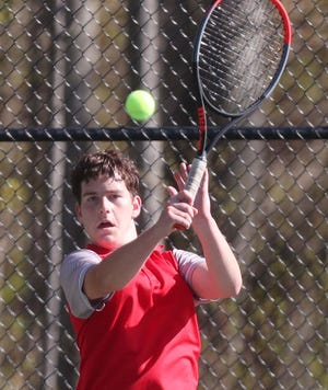 Wadsworth's Dylan Currans competes in the Suburban League National Conference Tennis Tournament on Friday. [Karen Schiely/Beacon Journal}