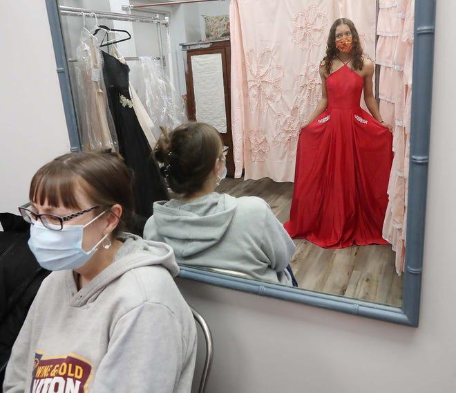 Melissia Leonard, left, the mother of Jensaya Leonard, 18, assists her daughter in choosing a prom dress at Rockin' Frocks April 30 in Northfield Center.