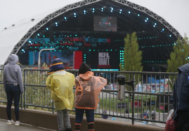 Fans view the Draft Stage from the outside concourse of FirstEnergy Stadium at the NFL Draft Experience on Thursday April 29, 2021.