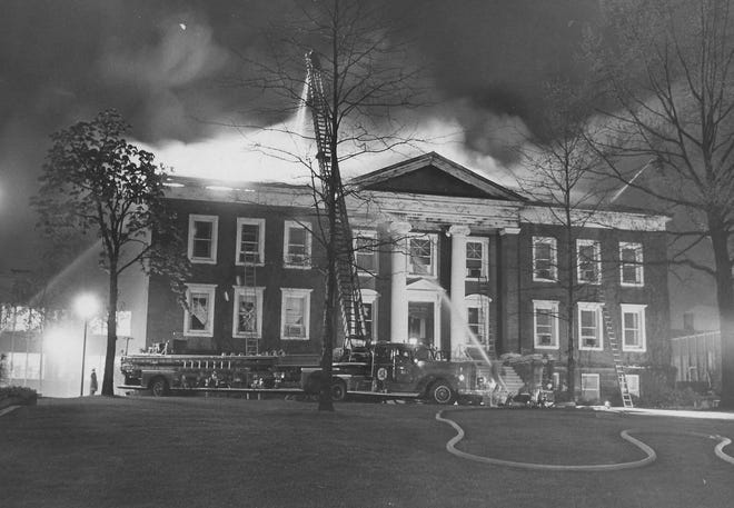 Firefighters battle an overnight blaze May 8, 1971, at Buchtel Hall at the University of Akron.