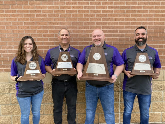 Canyon ISD band directing staff members hold the Sweepstakes awards each band one during a recent UIL competition. Pictured from left are, Ann Lough, director at Canyon Intermediate; Luis Hernandez, assistant director at Canyon High School; Eric Rath, CHS director; and Eric Perez, director at Canyon Junior High.