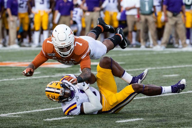 Texas safety Caden Sterns defends LSU's Ja'Marr Chase in Austin on Sept. 7, 2019. Sterns was drafted by the Denver Broncos on Saturday.