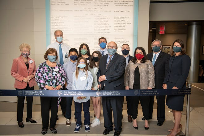 In the photo, Angela and Richard Clark, (front center) with family members cut the ribbon alongside Joan Parlee, far left, chair of the boards, Doylestown Hospital and Doylestown Health Foundation; Dr. Les Szekely, left, back row, medical director of Clark Center for Critical Care Medicine; Jim Brexler (right), president and CEO, Doylestown Health; and Laura Wortman, (far right) vice president and chief development officer, Doylestown Health.