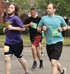 Adam Hardesty, right, was part of the male 25-29 group in last week's Shamrock the 'Ville 5K.