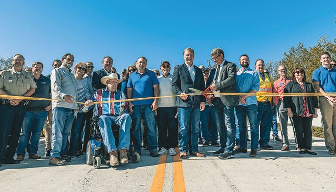 Congressman Kevin Hern and District Three Washington County Commissioner Mike Dunlap cut the ribbon during a ceremony for the the opening of Green Lake Bridge Friday, April 30.