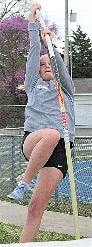 Bartlesville High's Quincey Turner goes all out during a practice jump following her arm injury and just a few days before seeing a new school girls' pole vault record.
