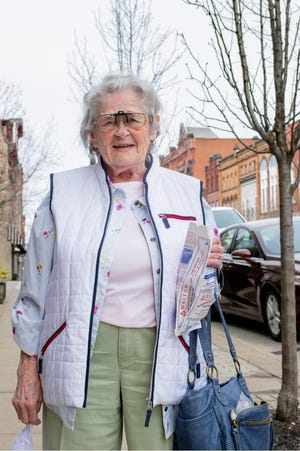 Dolores Wilson heads out of Cheffy Drugs ready to start her day. Wilson turned 92 years old in April. She remembers D-Day and once again passed her driver's license exam last November.