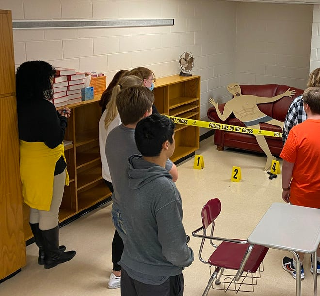 Brownwood High School  photography students study a mock crime scene during a presentation organized by officer Fred Bastardo and Cpl. Kimberly Holland from the Brownwood Police Department.