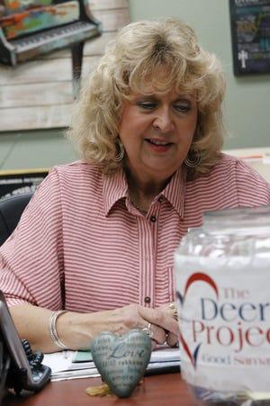 Good Samaritan Ministries Executive Director Leesa Stephens is pictured at her desk.