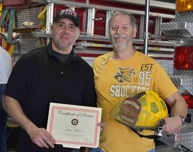 John Wilson, right, received a Certificate of Service recognizing his 32 years of volunteer service to the El Dorado Fire Department from Deputy Fire Chief Tony Yaghjian, left.