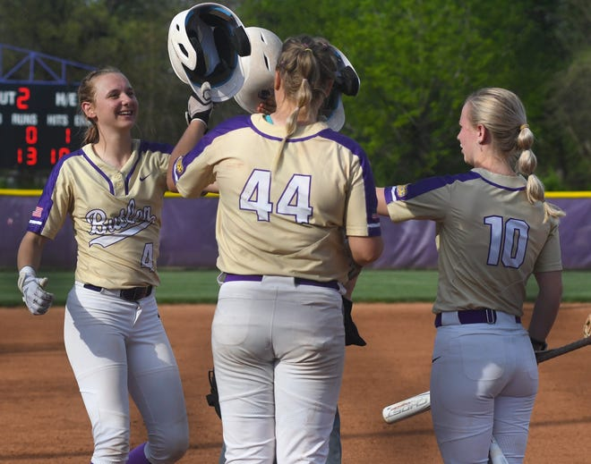 Butler freshman catcher Tadum Soetaert is greeted at home plate by teammates Anna Icenhower (44) and McKenna Jones (10) after hitting a home run during Thursday's 15-1 Game 1 win over Independence.