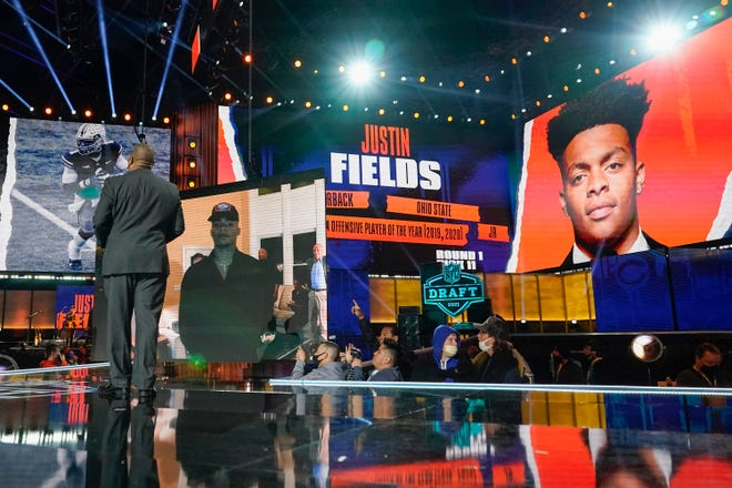 An image of Ohio State quarterback Justin Fields is displayed after he was chosen by the Chicago Bears with the 11th pick in the the NFL draft on Thursday.
