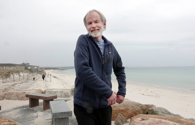 Woods Hole oceanographer Larry Pratt combines dance and science and projects and his classes. He performs some wave-style movement at Chapoquoit Beach in West Falmouth.
