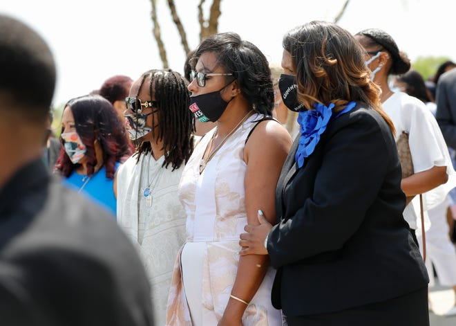 Paula Bryant, middle, stands with family following the funeral services for her daughter, Ma'Khia Bryant, at the First Church of God in Columbus in April.