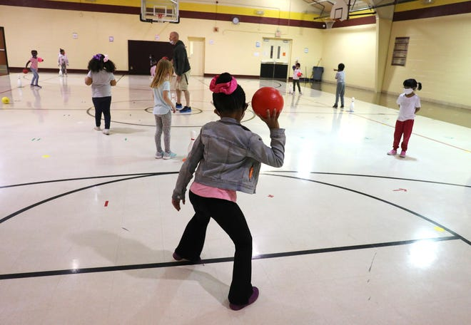 Kindergartners play in gym class at North Elementary School in Pataskala on Friday, April 30, 2021.