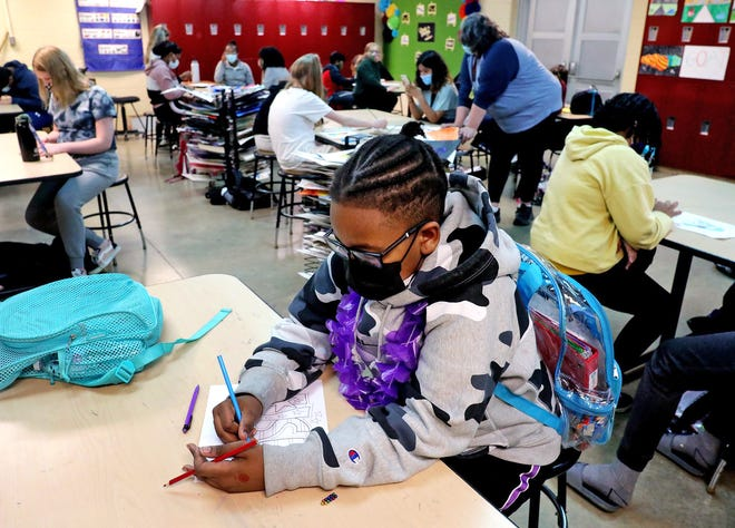 Fifth-grader Jondayle Tucker works on an assignment in art class at Central Intermediate School in Pataskala on Friday. The Ohio House incorporated an ambitious plan into its proposal for the state budget that would give $1.88 billion more to Ohio's public schools over six years.