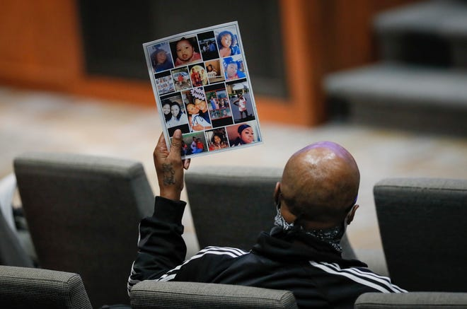 A visitor holds up a program with childhood photos during the funeral services for Ma'Khia Bryant at the First Church of God in Columbus on Friday, April 30, 2021. Bryant, 16, was shot and killed by a Columbus Police officer on April 20 during an altercation at her foster home on the Southeast Side.
