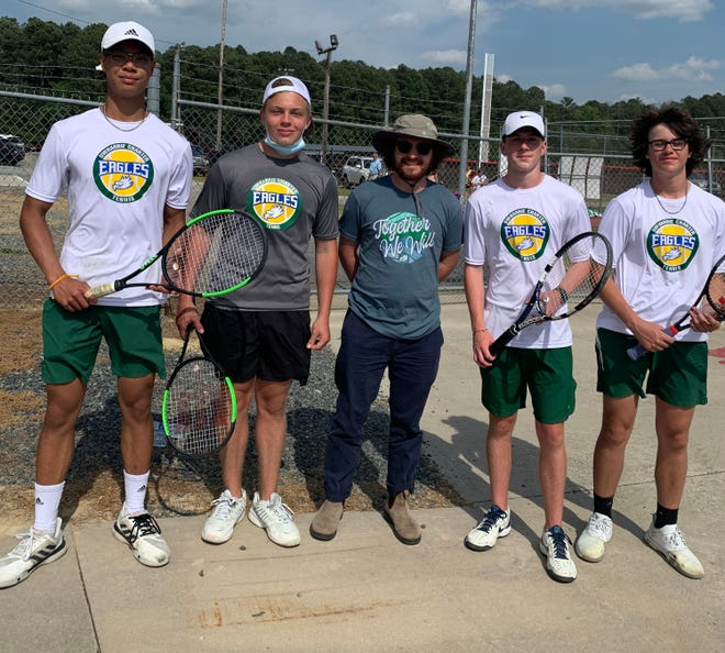 Pictured are the Uwharrie Charter boys tennis team. From left are Joseph Phetmixay, Drew Auman, Coach Drew Fortune, Carson Duggins, and Conner Kelly. [Courtesy photo]