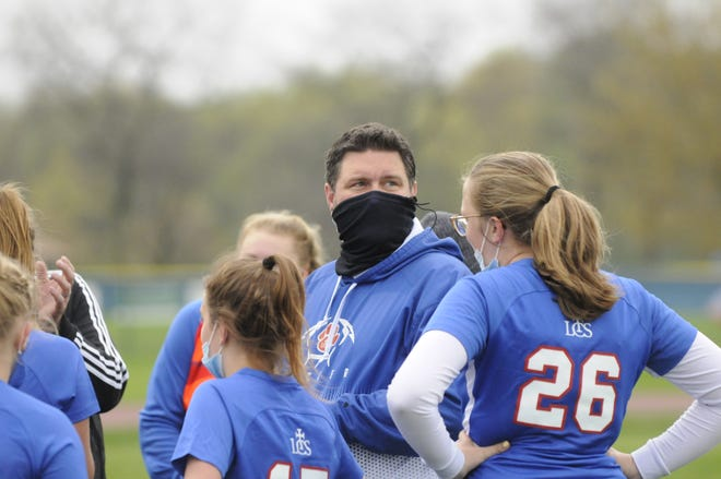 Lenawee Christian's Nathan Sharpe talks to his team on the sidelines during a game Thursday against Clinton.
