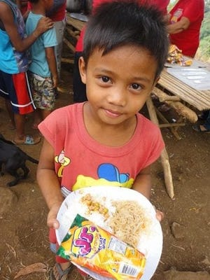 A feeding being held during better times in the villages. Now the children are starving and many are dying from COVID in the Philippines. Mission Love Seeds will be there again to  help.