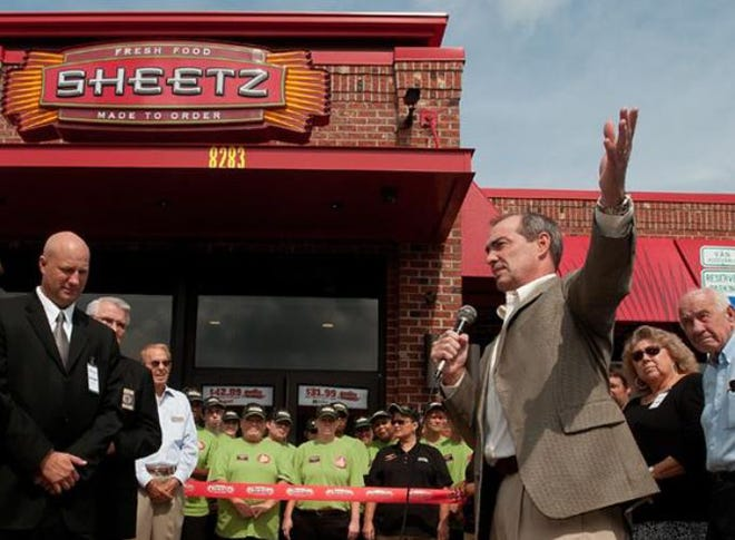 In this fle photo, Louie Sheetz, vice president of marketing for Sheetz Convenience Restaurants, speaks to the crowd gathered in August 2012 for the grand opening of the Sheetz store on Old U.S. Highway 52. The property has been sold to RCR Enterprises LLC.