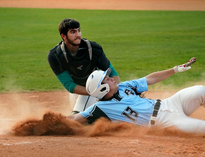 Ponte Vedra's Joe Hoben (13) scores at home sliding past the attempted tag of Pine Ridge catcher Chase Miller during Thursday's game.