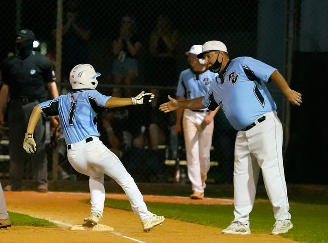 Ponte Vedra's Corey Udell (1) celebrates during the district championship baseball game against Pine Ridge.