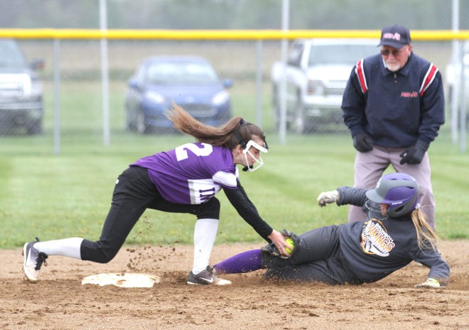 Bronson's Maddie Ratkowski is tagged out at second base by Athens' Zoey Williams trying to stretch a single into a double Thursday night