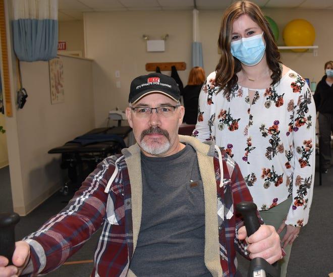 Christopher Robson with Maura McGowan, DPT at Wayne Memorial Rehabilitation Services/Delaware Street.