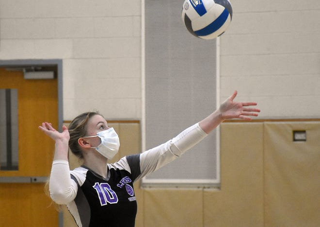 Little Falls Mountie Karlee Gullis tosses the ball for her serve during the third game of Thursday's match against the Herkimer Magicians. Gullis was error-free on 30 serves, a school record for a three-game match, and had nine aces.
