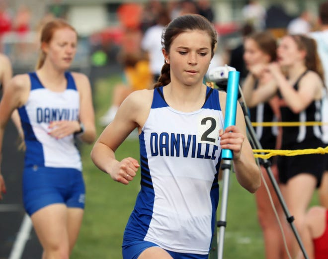 Danville's Jaeda Molle takes off after receiving the baton from Cassidy Yaley and went on to win the race, breaking the Danville cchool record for that event.