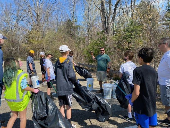Members of the Granite State Wild Bantam (13U) Minor Black team held a clean-up day in Dover.