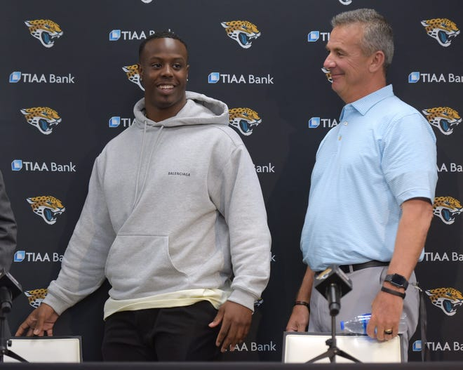 Former Clemson running back Travis Etienne and Jacksonville Jaguars coach Urban Meyer are all smiles at news conference following the NFL draft's first round.