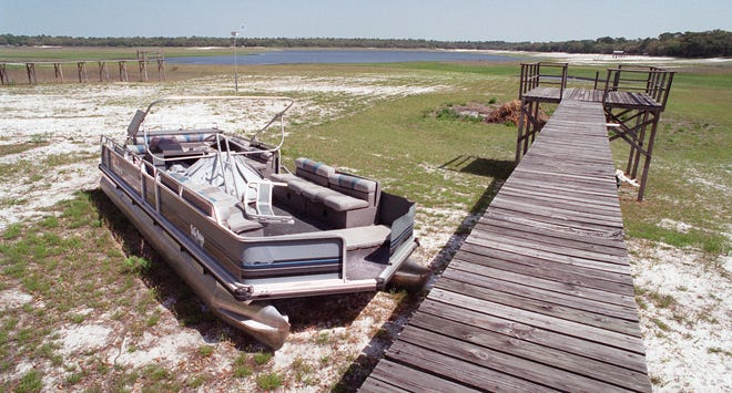 This photo of Lake Brooklyn's dry docks and receding shoreline was taken in 2001. Water management officials say a new strategy to restore the lake's health could raise water levels nearly 10 feet.