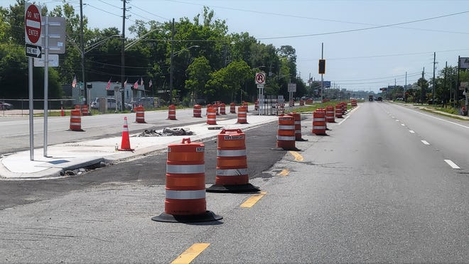 At Putnam Road, this is one of three turn lanes being built on Philips Highway with traffic signals and new curbing.
