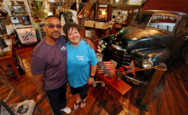 Owners Darrell and Stephanie Pope pose together inside their shop, Jumpin' Jed's, on Fallston Road in Lawndale Friday morning, April 30, 2021.