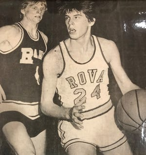ROVA's Roger Saline makes a move against a Riverdale defender during one of the Tigers' two games against the Rams during the 1975-76 season.