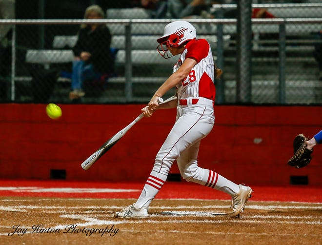 Glen Rose's Felicity Austin pounds out a double in the Lady Tigers' 6-4 playoff win over Graham on Thursday night.