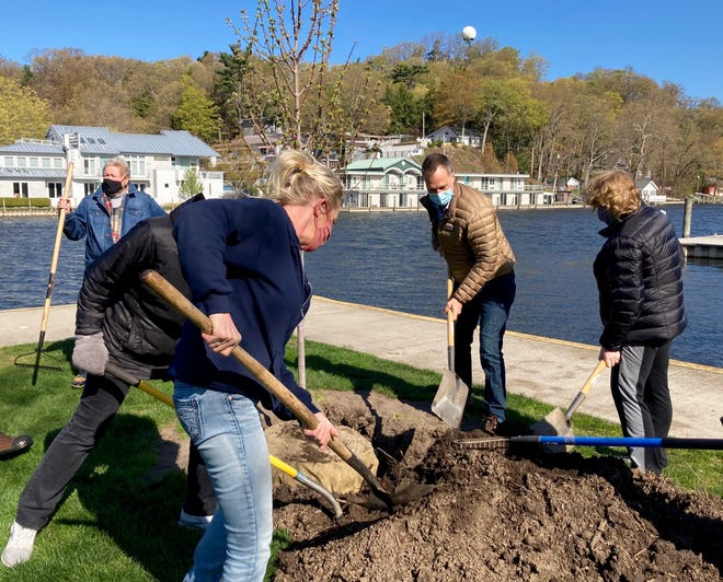 Saugatuck city staff, council members and members of the city's tree board plant a tree in Wicks Park in honor of Arbor Day on Friday, April 30, 2021.