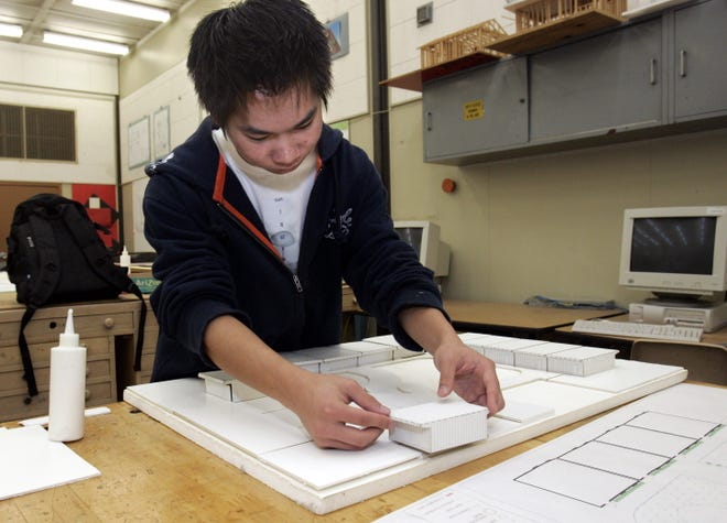 John F. Kennedy High School senior Matt Mui, 18, works on a three-dimensional model of new classrooms at the school during an architectural design class Friday, April 7, 2006, in Sacramento, Calif. The class is one of the updated versions of vocational education classes that were abandoned in the last two decades.