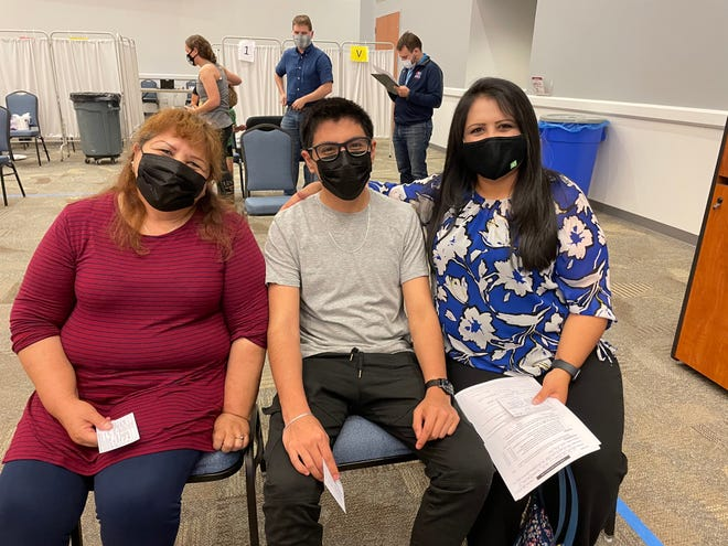 (From left) Esther Gonzalez Ibanez, 61, grandson Sergio, 18, and her daughter Heidi Cruz, 41, of Hendersonville are encouraging their fellow members of the Latinx community to get the COVID-19 vaccine.