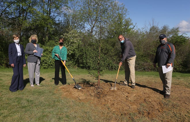 Arbor Day was recognized Friday morning at Community Park in Massillon. Pictured are Massillon Safety-Service Director Barb Sylvester (far left); Mayor Kathy Catazaro-Perry; Amy Hopkins, a FirstEnergy external affairs representative; Joe Pape, superintendent of the Massillon Parks and Recreation Department; and Steve Pedro, Parks & Rec director.